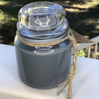 Glass jar with candle