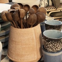 wooden spoons in terracotta pot