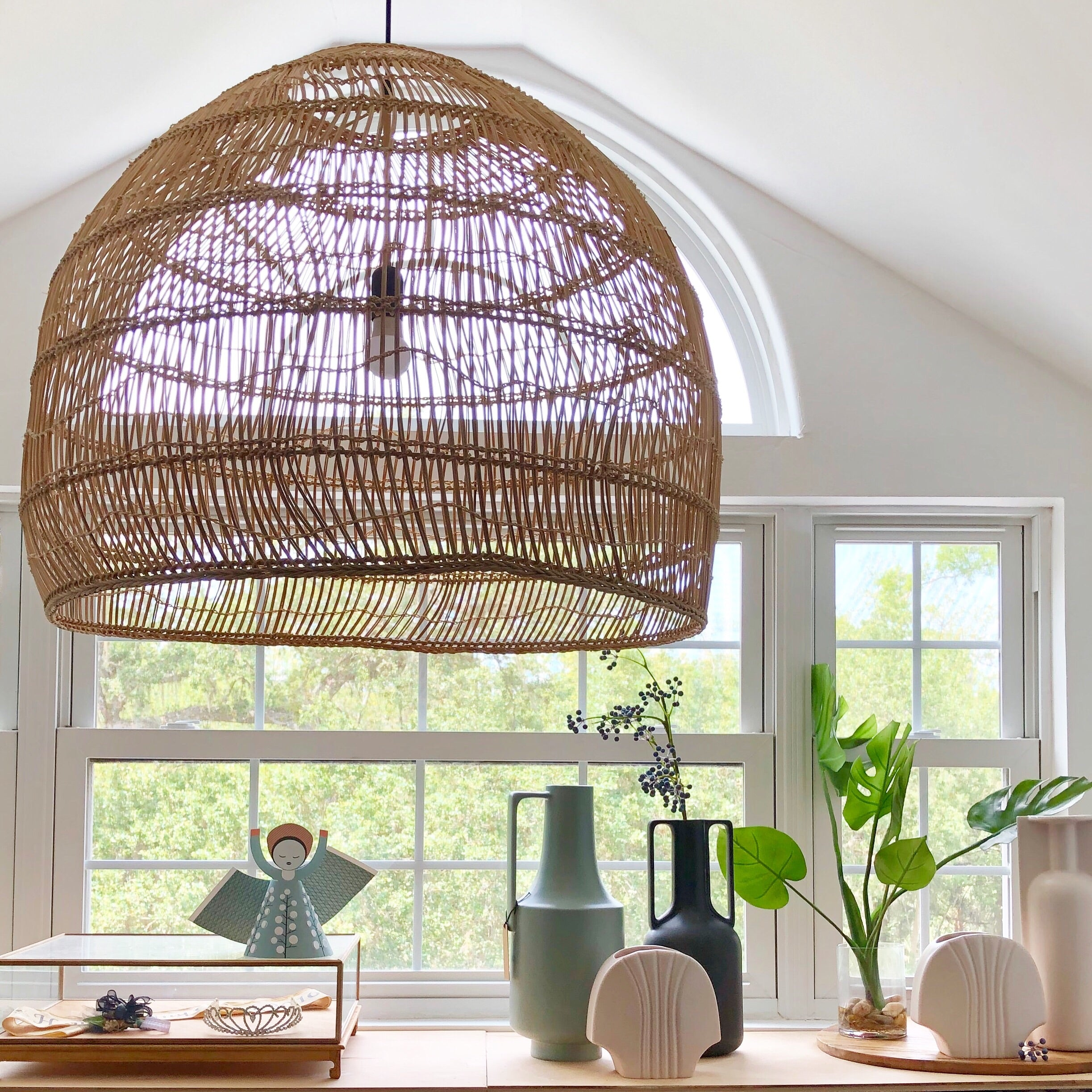 nordic style interior with big basket light and vases