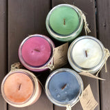 Set of 5 colored handmade soy candles in glass jars