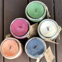 Set of 5 different color soy candles in glass jar
