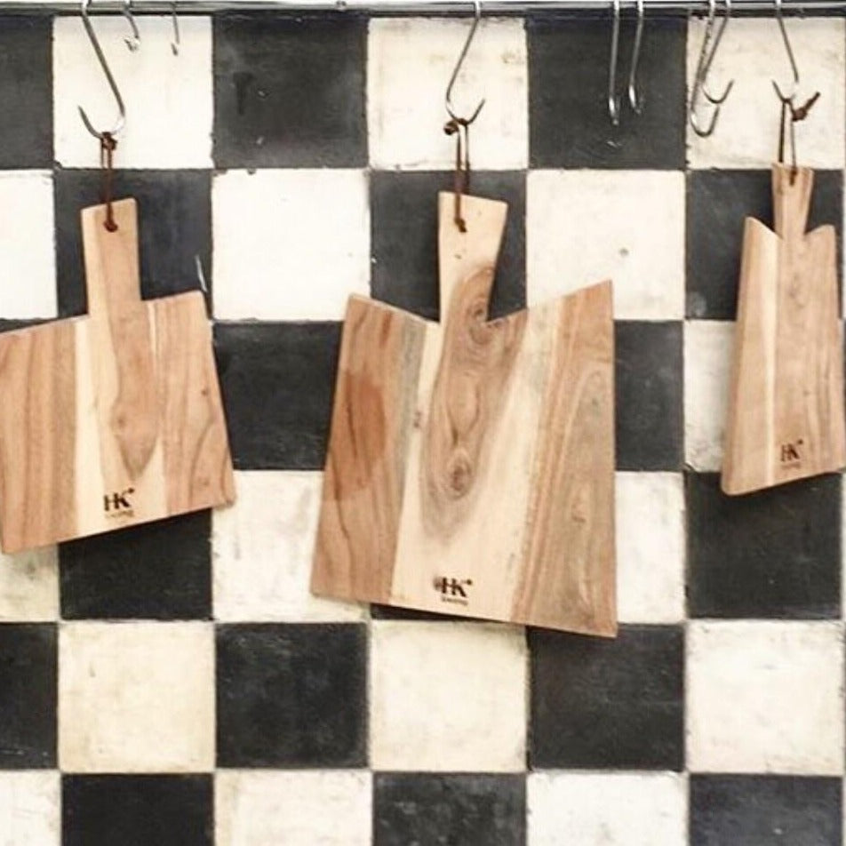checkered back splash in black and white with wooden cutting boards