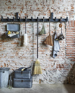 exposed brick wall with vintage brushes by hk living