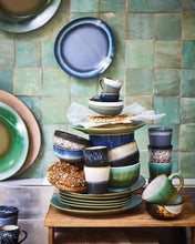 stack of multi colored ceramic bowls plates and mugs by hk living usa
