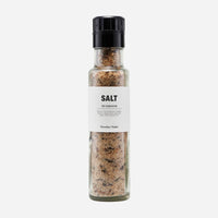 salt with dried mushrooms in a glass grinder bottle with Nordic designed label