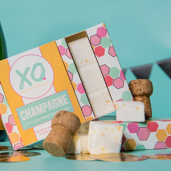 yellow, pink.blue, green and white colored packaging for marshmallows infused with champagne