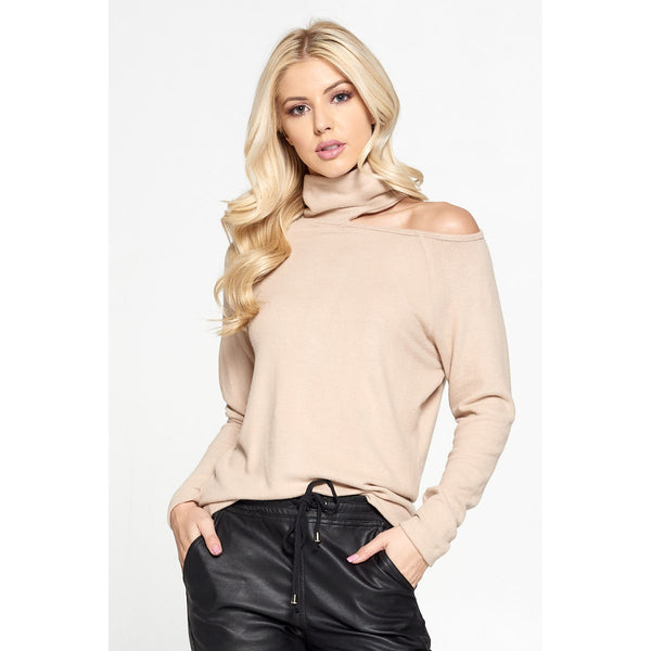 taupe colored sweater with turtleneck and one cold shoulder