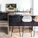 open kitchen with natural rattan counter stools in black white and naturel