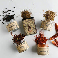 spices from around the worlds in beautiful glass jars and tins