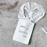 facial beauty mask in a white sachet