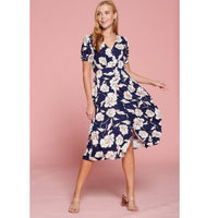 navy blue midi dress with large white flowers
