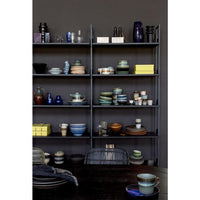 saucer in open shelving cabinet