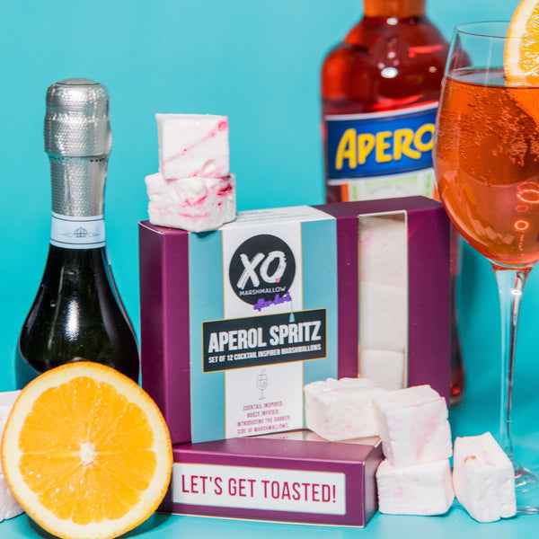 bottle of sparkling wine, aperol spritz and a box of infused marshmallows