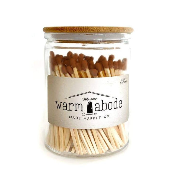 camel colored matches in a glass vessel with lid