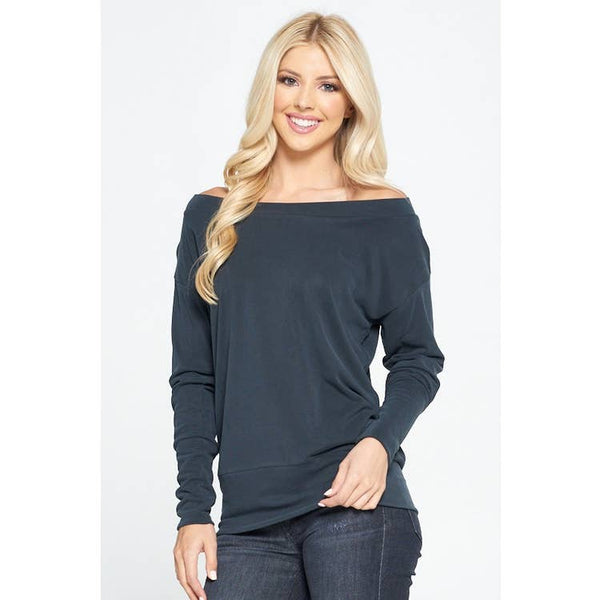 blond lady with dark jeans in combination with a black off shoulder knitted sweater