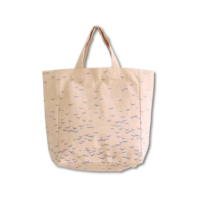 fair trade eco cotton bag in nude color with blue birds