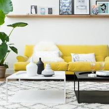 yellow couch and black and white steel coffee tables