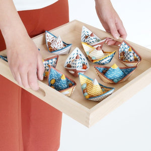 paper boats on a tray