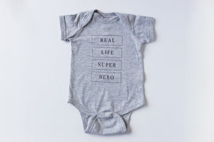 Real Life Superhero - Baby Onesie - Light Grey - Warrior Label Clothing