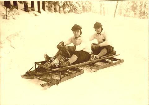 Two guys on a custom Northland Toboggan/Bobsled.
