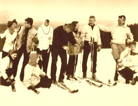 Collegiate skiers on old wood skis.