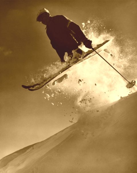 Jumping a cornice on old wood skis.