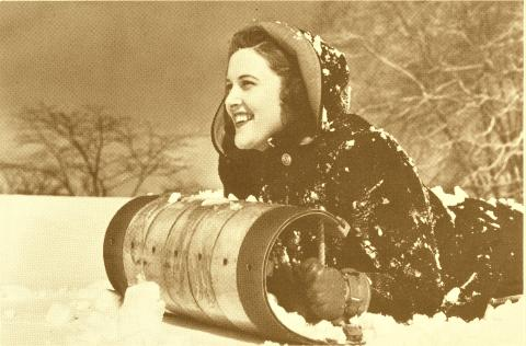 Girl on a Northland Toboggan.