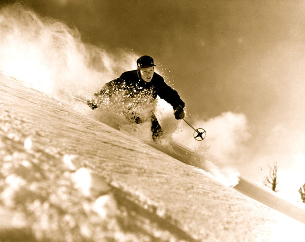 Vintage photo of Alf Engen skiing in powder.