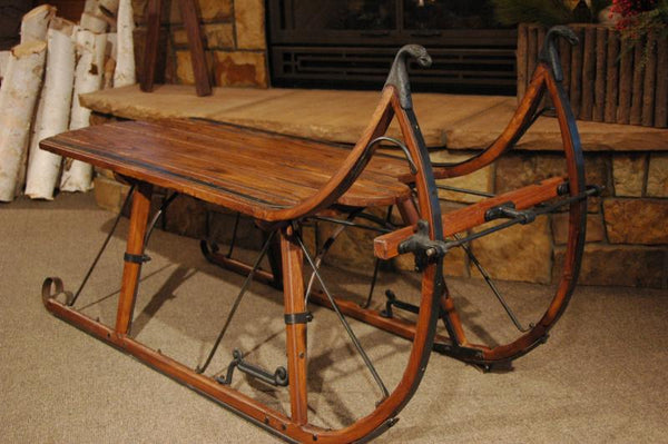 Sleigh coffee table eagle head albany cutter sleigh for Sled coffee table