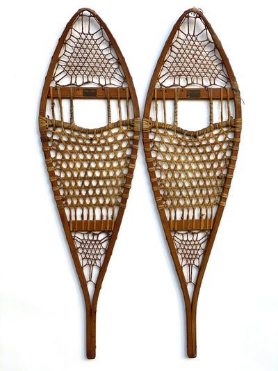 Vintage set of Abercrombie and Fitch Snowshoes with Brass labels and a golden alligator patina