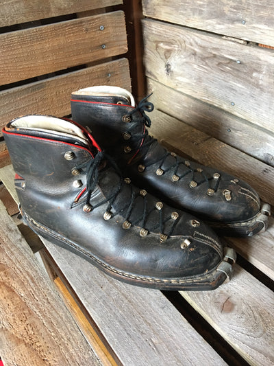 Classic Black Leather Ski Boots with Red Accents