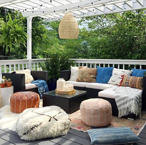 moroccan leather pouf outside deck