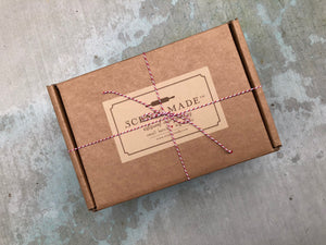 The outside of the Scenic Made artisinal care package.  Wrapped with bakers twine, the perfect gift box.