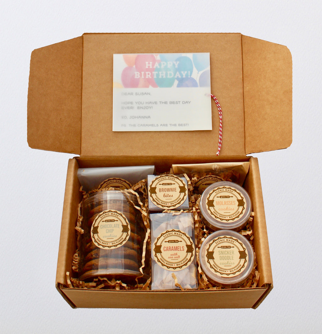 The original gluten free care collection.  Includes separate packages of the following items: chocolate chip cookies, molasses cookies, snickerdoodles, caramels, brownie bites, granola, and cheese coins.  A personalized note is put inside a translucent wrap on the interior of the box.  The card had a ribbon attached to it so the card is easily pulled out, and can be displayed on a bulletin board or refrigerator.