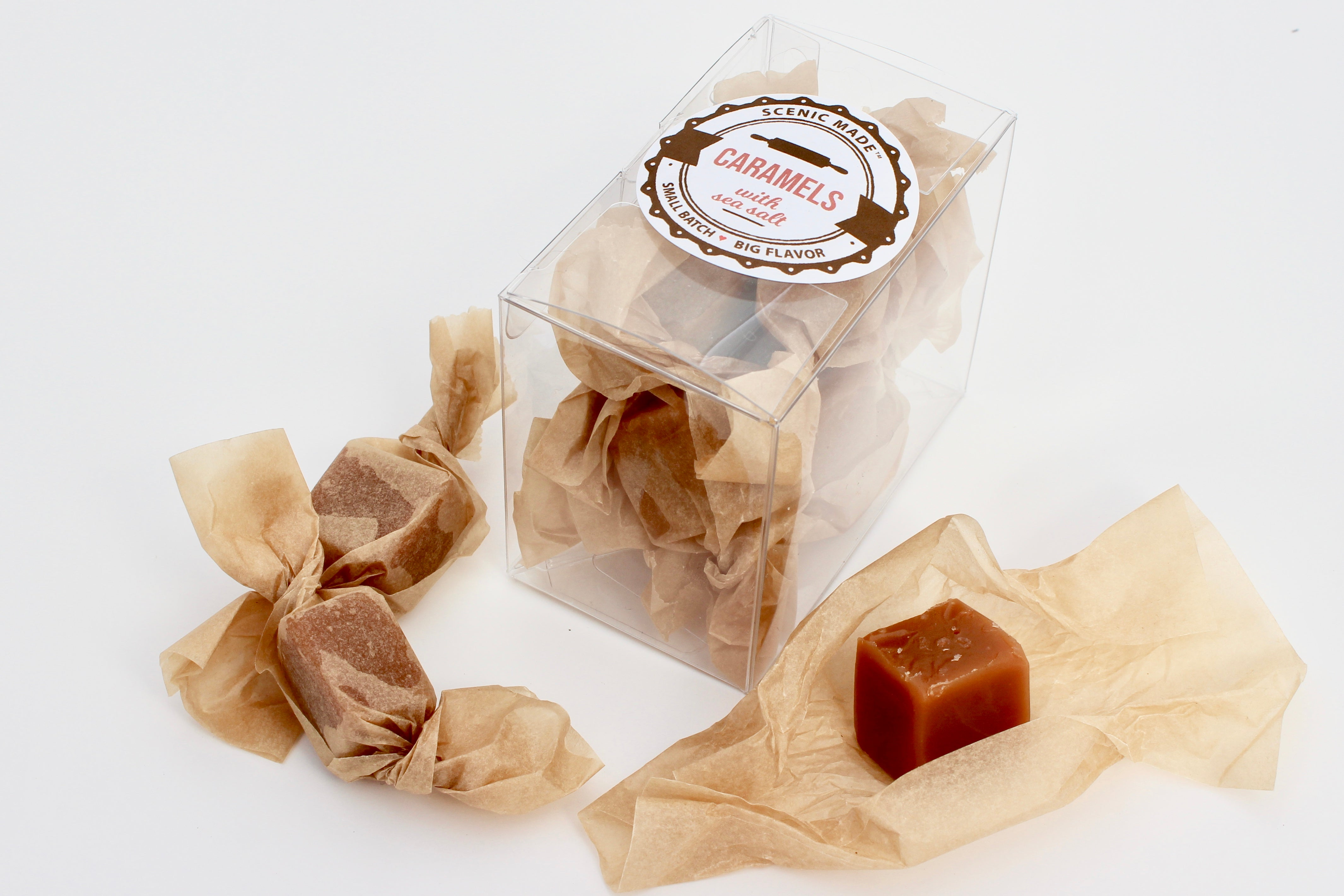 Homemade caramels, individually wrapped with unbleached parchment paper.  8 caramels are packed into a clear, rectangular food safe container with an attractive label on the front.
