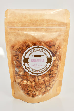 Crunchy granola with nuts and dried fruit.  2 ounces of granola, packed in a Kraft colored food safe bak with a clear front. Bag is resealable and has an attractive label on the front/