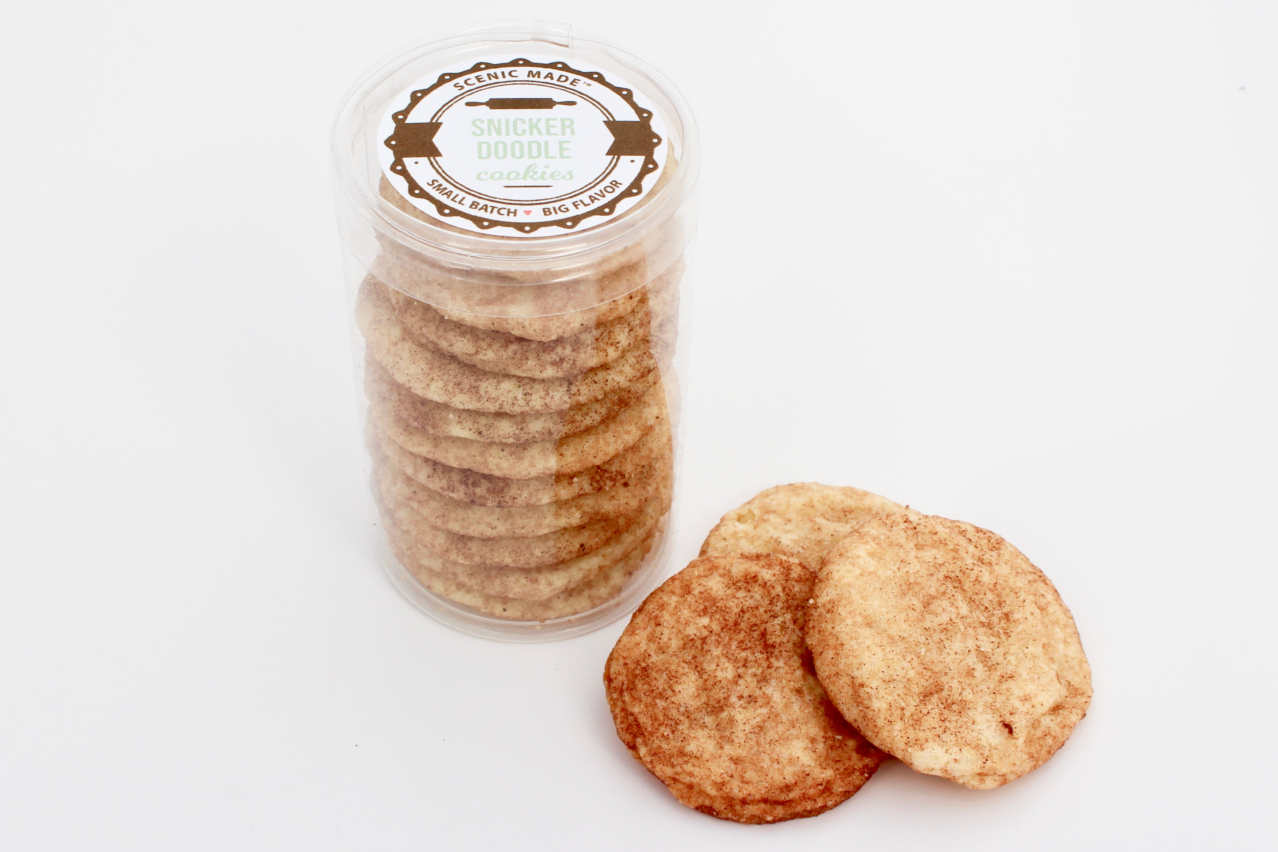 Snickerdoodle cookies.  10 cookies stacked in a clear, food safe container with an attractive table on the top.