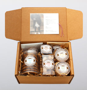 The original artisan care package.  Includes separate packages of the following items: chocolate chip cookies, molasses cookies, snickerdoodles, caramels, brownie bites, granola, and cheese coins.  A personalized note is put inside a translucent wrap on the interior of the box.  The card had a ribbon attached to it so the card is easily pulled out, and can be displayed on a bulletin board or refrigerator.