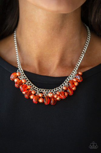 A collection of glassy and pearly orange beads dangle from the bottom of interconnected silver chains, creating a flirtatious fringe below the collar. Features an adjustable clasp closure.   Sold as one individual necklace. Includes one pair of matching earrings.   Always nickel and lead free.