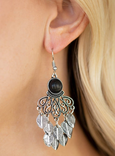 Dainty silver leaves cascade from the bottom of an ornate silver lure, creating a whimsical fringe. An earthy black stone is pressed into the top of the frame for a seasonal finish. Earring attaches to a standard fishhook fitting.  Sold as one pair of earrings.  Always nickel and lead free.