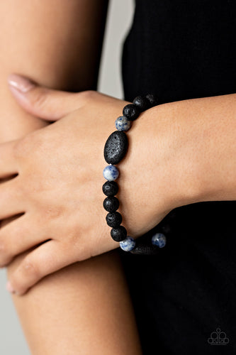 Essential Oil Alert!! A collection of black lava rocks and earthy blue stone beads are threaded along a stretchy band around the wrist for a seasonal look.  Sold as one individual bracelet.  Always nickel and lead free.