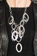 Load image into Gallery viewer, Large silver links and shimmering textured silver rings cascade below a silver chain freely, allowing for movement that makes a bold statement. Features an adjustable clasp closure.  Sold as one individual necklace.Includes one pair of matching earring.  Always nickel and lead free.