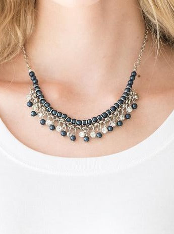 Infused with silver chain, blue pearls are threaded along an invisible wire below the collar. Matching blue pearls and glittery white rhinestones swing from the pearly strand, creating a flirtatious fringe below the collar. Features an adjustable clasp closure.  Sold as one individual necklace. Includes one pair of matching earrings.  Always nickel and lead free.