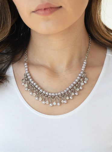 Infused with silver chain, silver pearls are threaded along an invisible wire below the collar. Matching silver pearls and glittery white rhinestones swing from the pearly strand, creating a flirtatious fringe below the collar. Features an adjustable clasp closure.  Sold as one individual necklace. Includes one pair of matching earrings.  Always nickel and lead free.