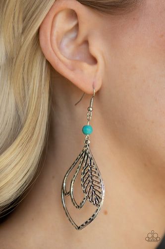 Featuring a hammered antiqued finish, feathery silver frames overlap inside of a silver teardrop frame. The whimsical frame swings from the bottom of a smooth turquoise stone bead for a seasonal finish. Earring attaches to a standard fishhook fitting.  Sold as one pair of earrings.  Always nickel and lead free.