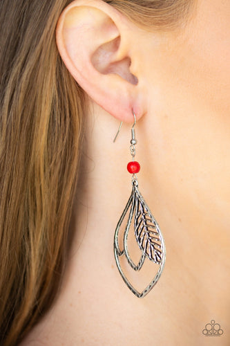 Featuring a hammered antiqued finish, feathery silver frames overlap inside of a silver teardrop frame. The whimsical frame swings from the bottom of a smooth red stone bead for a seasonal finish. Earring attaches to a standard fishhook fitting.  Sold as one pair of earrings.  Always nickel and lead free.