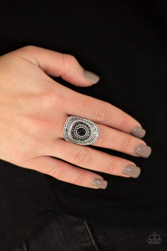 Radiating with sunburst textures, shiny black beads are pressed into a studded silver frame for a seasonal look. Features a stretchy band for a flexible fit.  Sold as one individual ring. Always nickel and lead free.