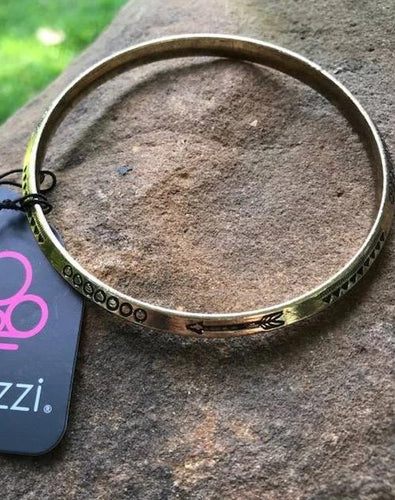 Stamped in geometric and arrow patterns, an antiqued brass bangle slides along the wrist for a tribal inspired look.  Sold as one individual bracelet.  Always nickel and lead free.  Exclusive