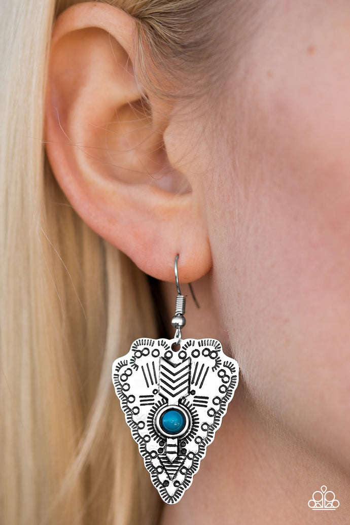 A  blue bead is pressed into a silver arrowhead frame embossed in a tribal arrow pattern for an indigenous look. Earring attaches to a standard fishhook fitting.  Sold as one pair of earrings.  Always nickel and lead free.