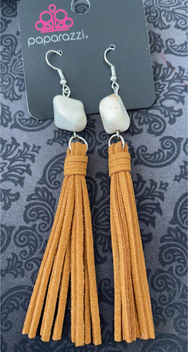 Natural earthy earrings, soft brown suede tassels hang from a polished white sandstone. 3.5